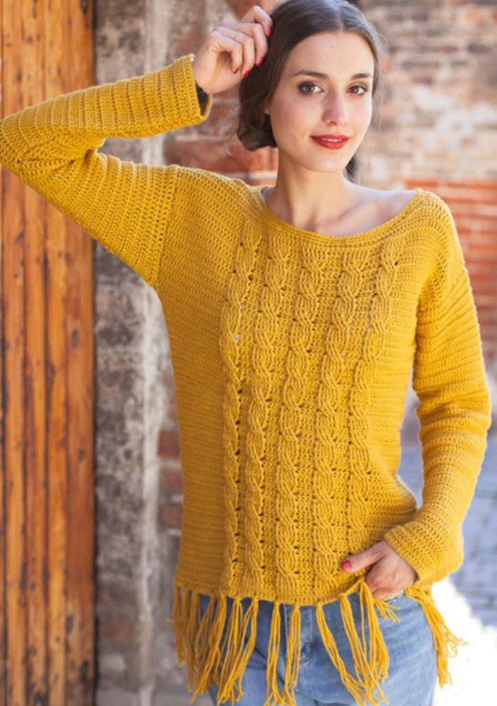 Желтый пуловер крючком с узором из кос